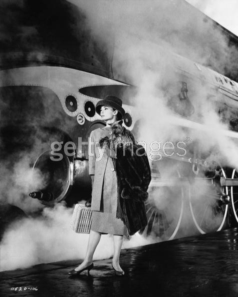 Audrey Hepburn stepping off a train.