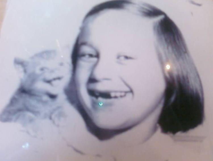 happy girl and her kitten circa 1940